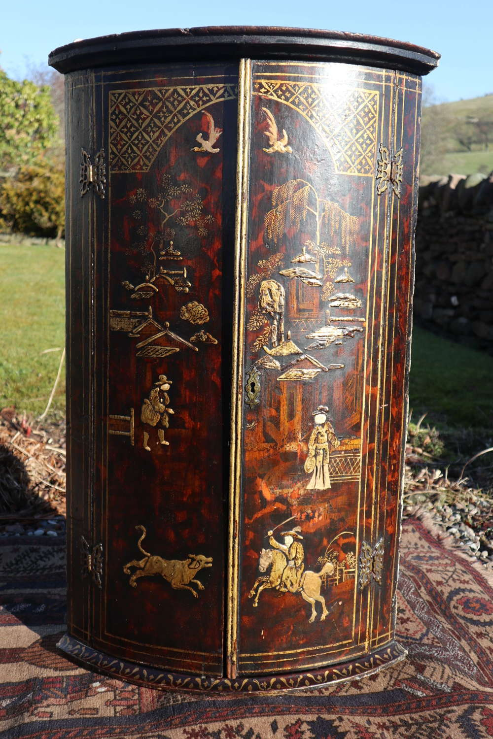 18th Century George III bow-front chinoiserie corner cupboard, c.1790.