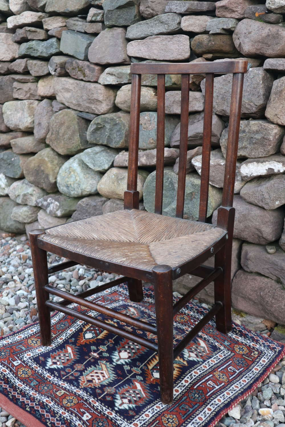 Arts & Crafts style child's dark oak & rush seated wooden chair c.1945