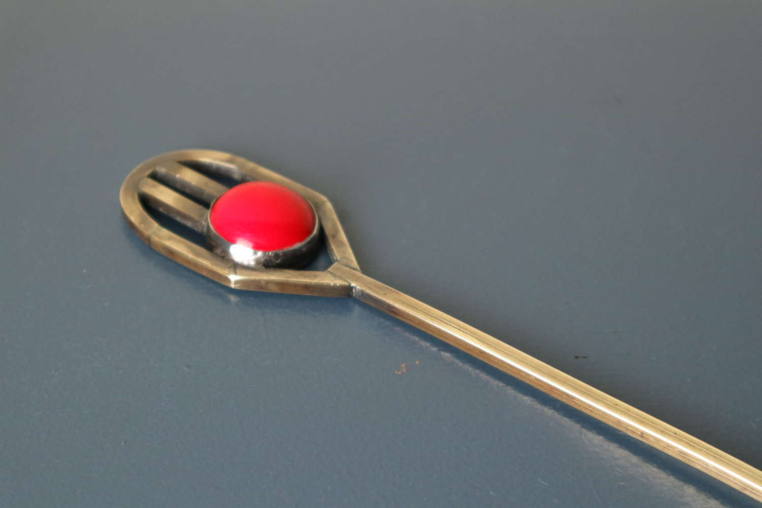 Art Deco brass & red bakelite cabochon geometric toasting fork c.1925.