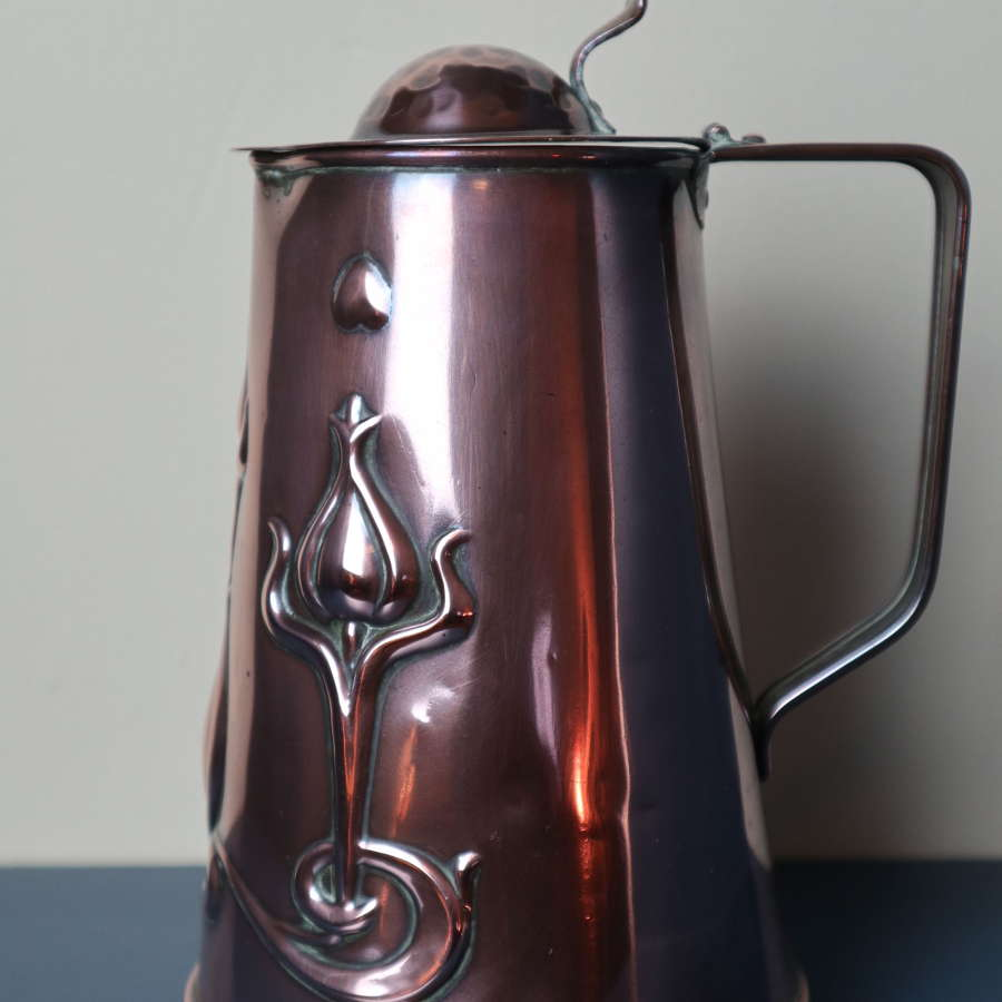 Arts & Crafts / Art Nouveau decorated copper water jug c.1905.