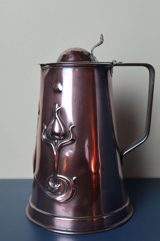 Arts & Crafts / Art Nouveau decorated copper water jug c.1905.