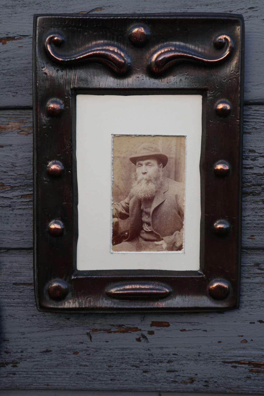 Arts & Crafts repoussé copper decorated photograph frame c.1900.