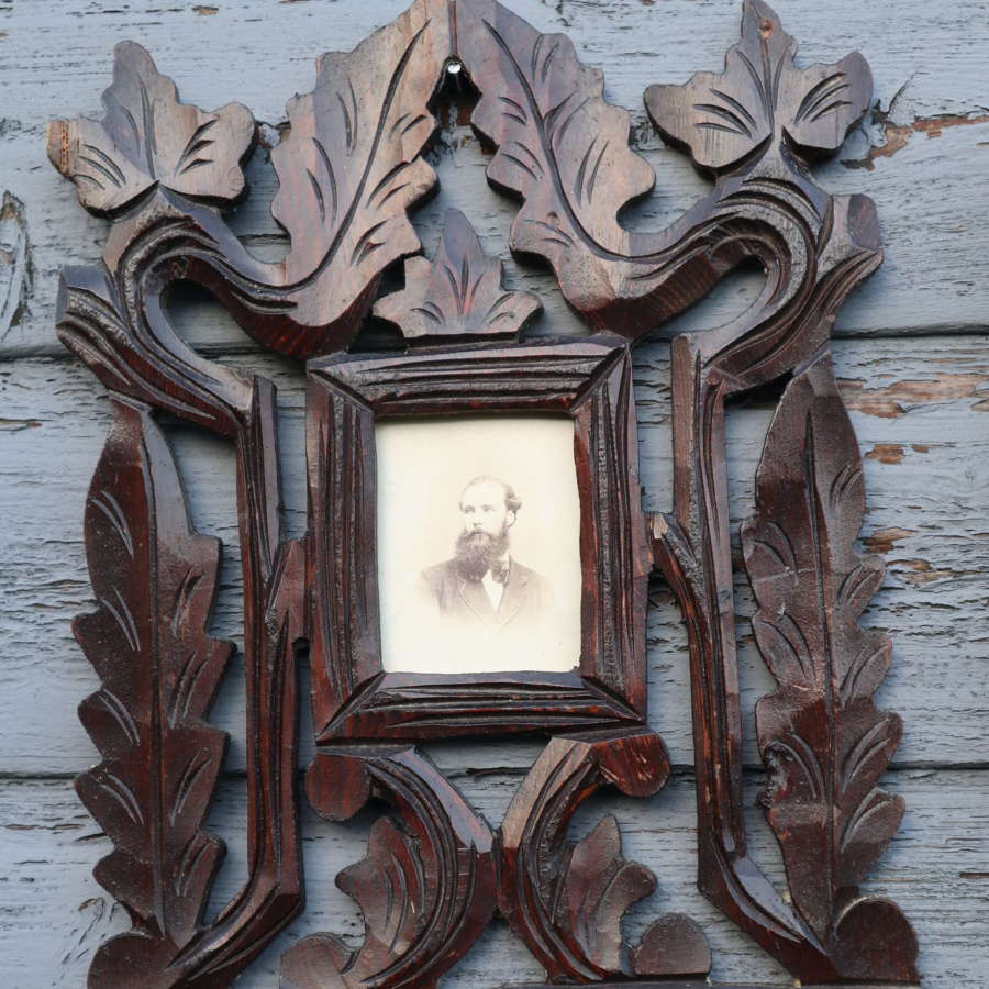Arts & Crafts oak leaf carved portrait photograph frame.