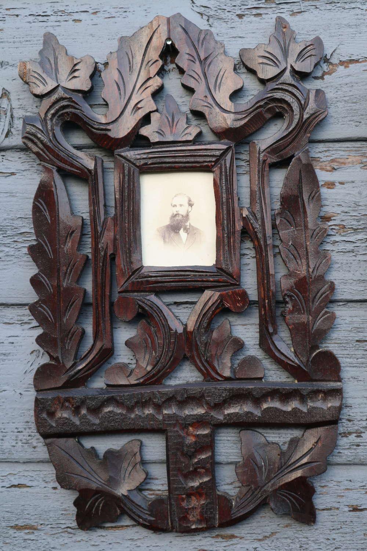 Arts & Crafts oak leaf carved portrait photograph frame.