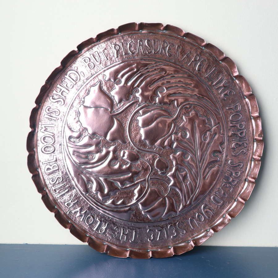 Arts & Crafts repoussé copper charger central poppies & motto c.1910.