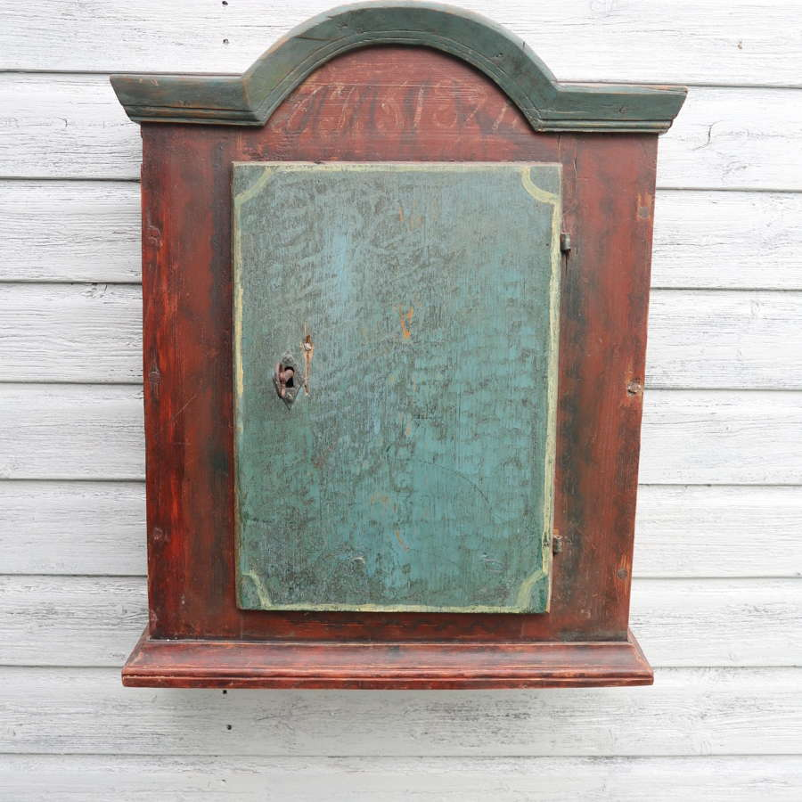 Swedish 'Folk Art' Baroque style painted hanging wall cabinet c.1821.