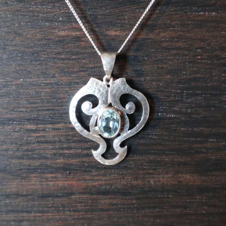 Art Nouveau hammered silver, whiplash & stone set pendant c.1905