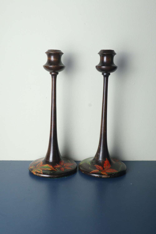 A pair of Art Nouveau floral painted wooden candlesticks c.1900-1910
